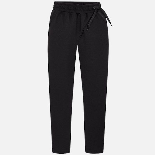 Loose trousers for girl with an elastic waist and thick drawstrings for a better fit. These modern trousers have two non-functional front pockets. It is a very versatile garment easy to match with blouses and T-shirts.