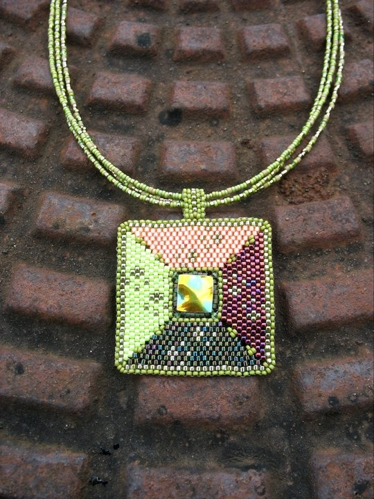 """""""cube"""" necklace  in the middle is a piece of an antique broken vase with Japan pearls"""