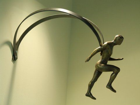 Runner. Wall placed sculpture. Patinated bronze. Signed and numbered.Dimensions Appx 40cm x 17cm x 22cm. Price 500 €