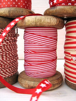 spools of red patterned ribbon