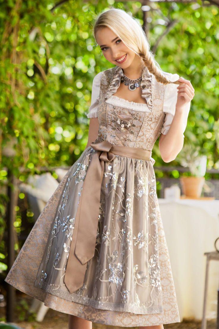 Das edle Designer Dirndl Lesandra ist ein champagnerfarbener Wunschtraum jeder Braut oder Dirndl-Fashionista! Versandkostenfrei & auf Rechnung!
