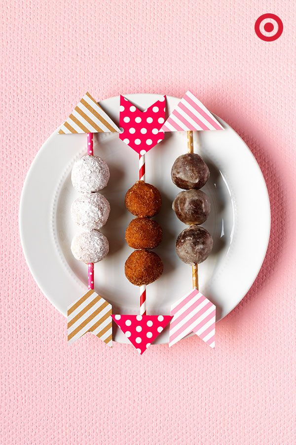 Cupid's arrows made out of Spritz straws and flags are an effortlessly sweet way to serve up donut holes—and show your love—on Valentine's Day.