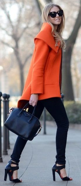 Orange is my favorite color. Love the heels and skinny black pant paired with the statement coat.