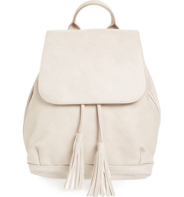 Playful tassels add trend-right embellishment to this sized-down backpack crafted from rich faux leather.