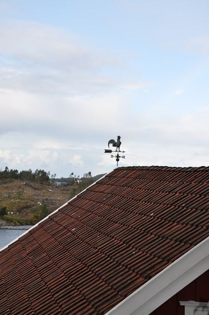 Weather vane on the top of the barn roof