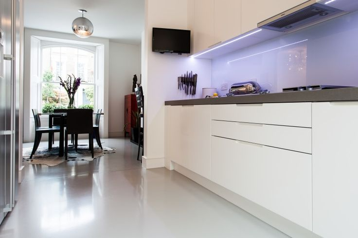Resin floors proving there's no need to settle for cold, hard concrete!   HomeSphere in Motion Carbon Steel, Private Residence