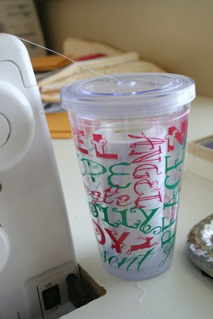 put thread cone in a reusable cup without the straw to keep it threading evenly into your machine!