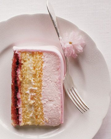 layers of genoise, cherry jam, pastry cream and whipped cream covered on pink fondant