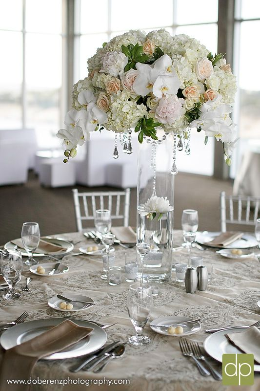 hanging crystals for wedding centerpieces. tall lush floral centerpiece with hanging crystals for wedding centerpieces