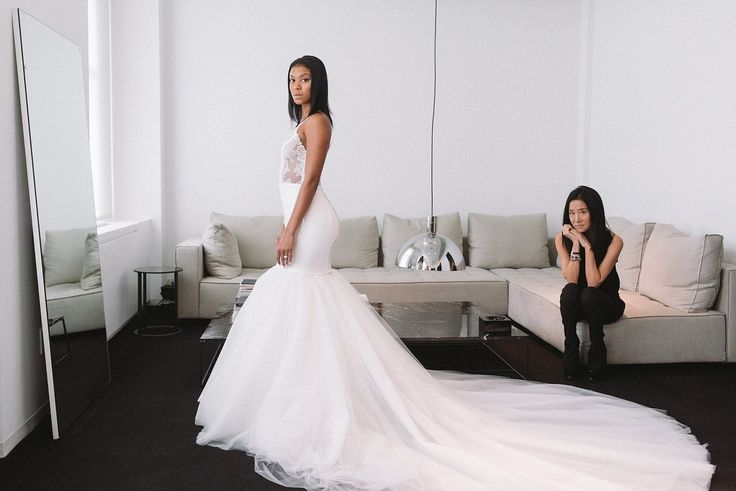 Check out the behind the scenes Vera Wang dress fitting for Eniko Parrish.