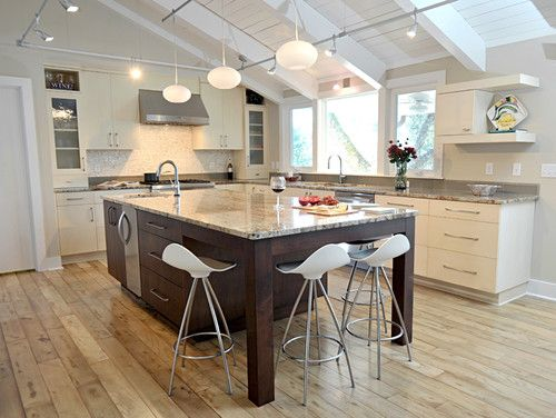 Modern kitchen island with seating on the end and corner for Dining room sink designs