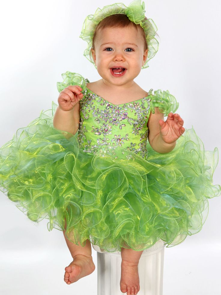 Your baby girl will look so cute and sweet when you slip her into this UFB034 Unique Fashion cupcake piece featuring stunning off the shoulder ruffled sleeves. The v-neckline bodice is adorned with floral beaded patterns, while a crown-stealer tutu skirt is decked out in tons of festive ruffles. We offer the most stunning accessories and pageant shoes to complete your baby's pageant look.