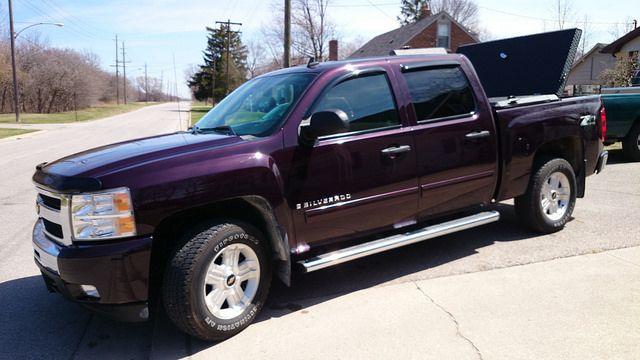 Purple Chevy Silverado With Hard, Black Truck Bed Cover by DiamondBack Truck Covers, via Flickr