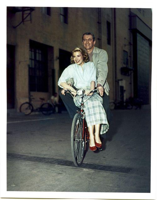jimmy stewart + grace kelly on a  bike