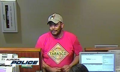 AURORA, Colo. -- Aurora Police and the FBI Rocky Mountain Safe Streets Task Force need your help to identify a bank robbery suspect. They released surveillance pictures that clearly show the suspect wearing a red shirt with a Tabasco logo and a baseball cap. The Chase Bank location at 16750 East Quincy was robbed on Friday, July 28 around 6:00 p.m., according to the Aurora Police Department.