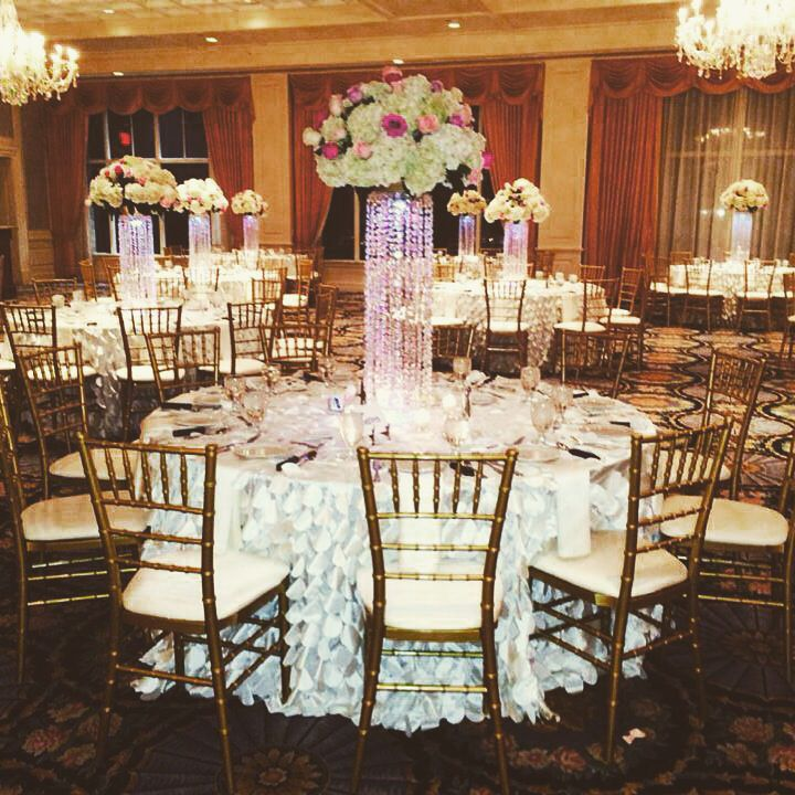 Modern meets classic with our gold chiavari chairs and floor length white linens. #affairstoremember #michigan  #elegance #weddings #classic #chiavarichairs #gold #white