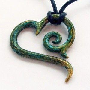 HEART PENDANT...reminiscent of Maori fish hook in bone