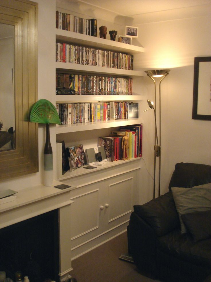 Alcove cupboard with floating shelves above, Putney