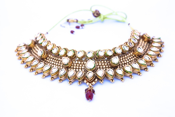 Deck yourself out like an Indian Princess with scales of muted gold and glassy kundan stones in circlets and teardrops. These pieces emanate posh style and grace while allowing you to do a bit of showing off. The high quality craftsmanship is a beauty to behold, much like you on your wedding day. Includes matching tikka. Rent: $200 Buy: $550 http://borrowitbindaas.com/semi-precious-spectacle-bridal-set