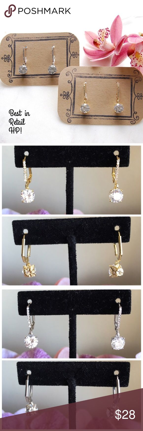 "CZ Dangling Earrings Perfect cubic zirconia earrings for any occasion! Solitaire CZ is 2 karats and hangs from a bar of more CZs. Hangs 1"" long. Available in either gold (1 left) or silver. Price listed is for one pair. Includes box. Price firm unless bundled. {E1629}   Instagram: @bringingupsuns Jewelry Earrings"