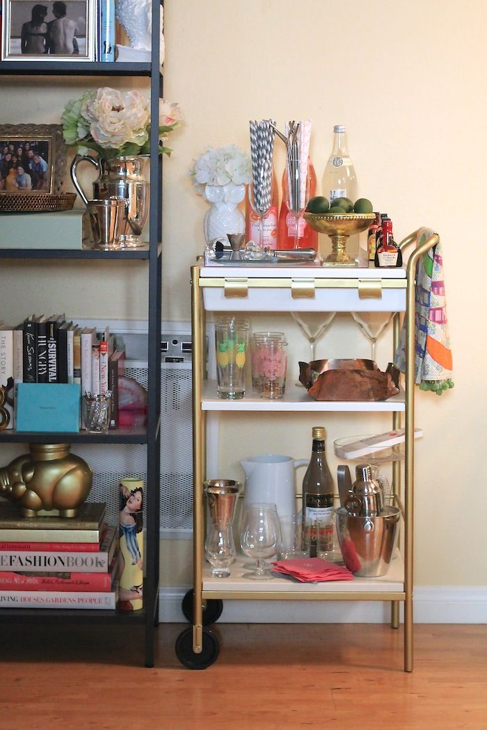 this ikea hack bar cart is so cute.  love the gold spraypainted hardware.