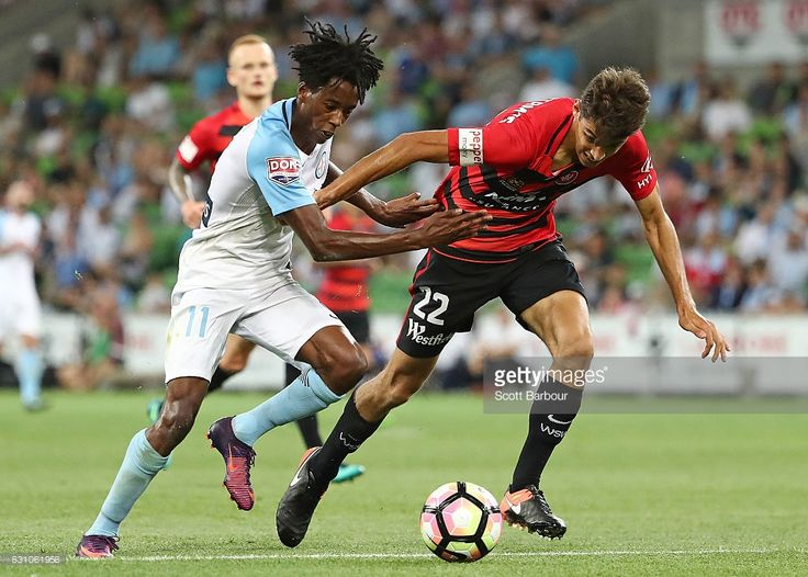 Bruce Kamau of City FC and Jonathan Aspropotamitis of the Wanderers compete for the ball during the round 14 A-League match between Melbourne City FC and the Western Sydney Wanderers at AAMI Park on January 6, 2017 in Melbourne, Australia.