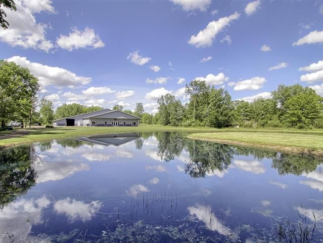 CommercialRetreat FacilityChurchAssistant Living in the fastest growing area 42 acres plus 2 ponds stocked with fish. Swimming pond use your imagination you can make this one work Fast growing area Property features a barn with 8 horse stalls with indoor arenaviewing station offices-17208 sq.ft. a must see Paved trail two ponds plus pole barn 1440 sq.ft. full power plus other accessory building. Parcel park like wooded setting clubhouse windoor 72x135 horse riding arena built in 1997. Ideal…