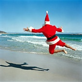 Father Christmas on a beach in New Zealand, for a summer kiwi Christmas