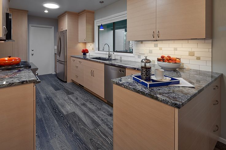 Forest Park Contemporary Azul Kitchen  -  During the design process, one of the most exciting things is seeing one of our clients become ridiculously excited over a product or material. In this case, that material was a single slab of Bahia Azul Granite... the most brilliantly blue stone we've ever worked with. The rest of this Portland, Oregon kitchen remodel followed in its watery blue path.   Photography: Dale Christopher Lang