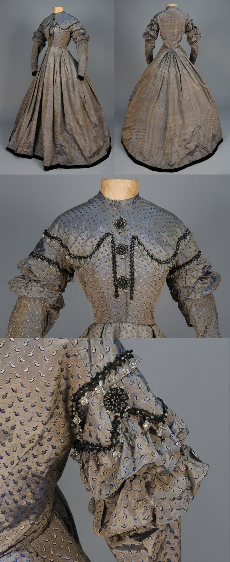 Day dress, 1850s, British, (Lancashire), one-piece blue-grey taffeta (changeable shot-silk) brocaded with a repeat of tiny dots and abstract devices, the bodice decorated with black cord, clear and black beads, long sleeve with narrow cap and two puffed bands, sleeve and full, pleated skirt hemmed in black velvet, hook closures with bound holes in silk, muslin lining. B-33, W-23, L-58. From Whitaker Auctions