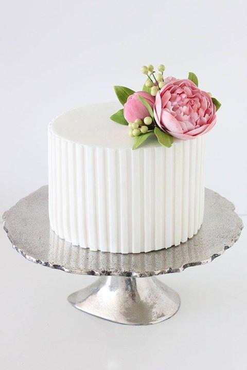 Single tier wedding cake with closed sugar peonies