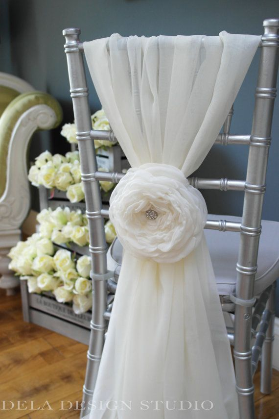 White fabric chair flower by DelaDesignStudio; perfect for the back of the bride's chair