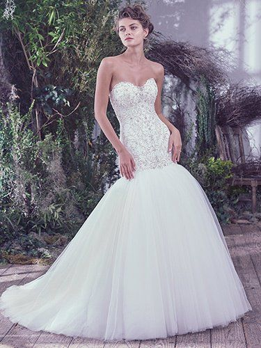 Maggie Sottero - DARYL, Intricate embroidery and beaded embellishments featuring Swarovski crystals are artistically woven onto the fitted drop waist bodice of this feminine fit and flare wedding dress. A soft scoop neckline and a voluminous tulle skirt add an extra dose of romantic elegance. Finished with corset or zipper closure.