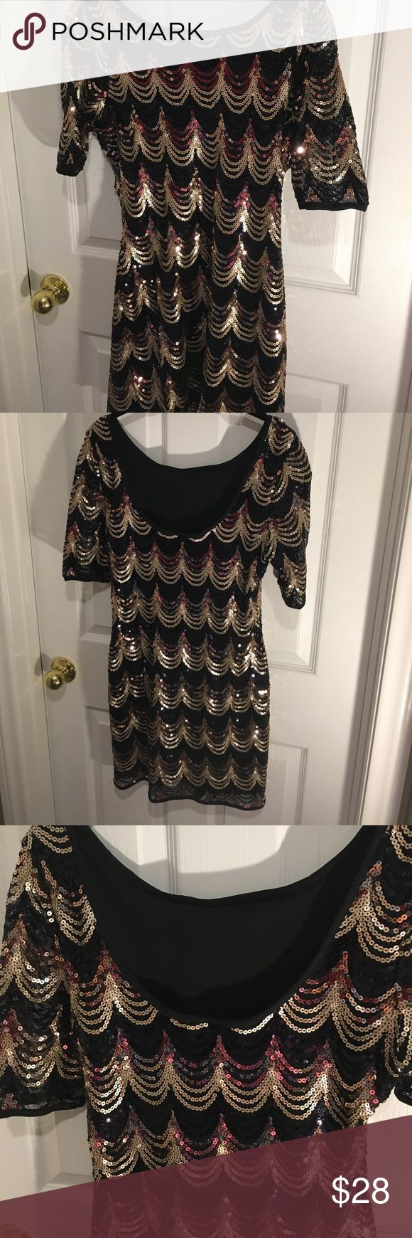 NWOT Shiny Cocktail Venus Sequin Dress Size M / 6 Shiny Sequined Patterned Dress by Venus  , Fully lined , hand washable - would fit a 6 perfectly ( labeled as M). No tags . This dress shows no signs of wear and has no flaws 👌Lower in back than in front , 1/2 sleeve. VENUS Dresses
