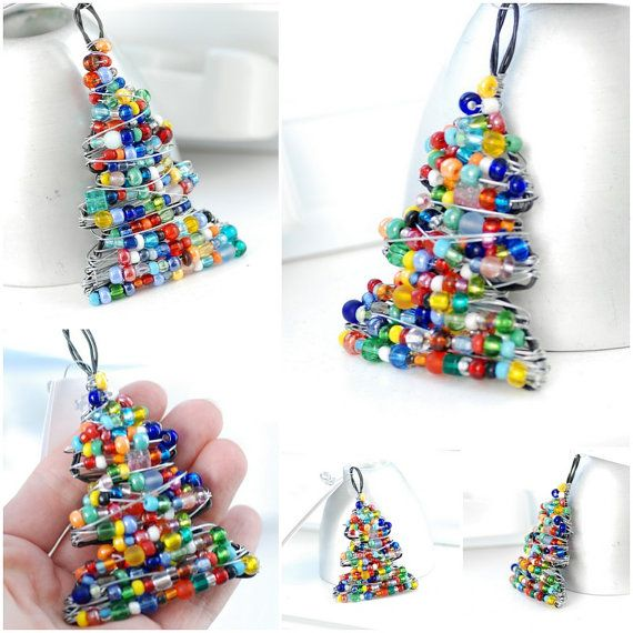 Handcrafted, wire-wrapped and beaded Christmas tree ornament is made with a combination of dark colored annealed steel and bright steel wire and a multi-colored mix of glass, resin, lucite and crystals. I create each tree individually including the frame and all wrapping, beginning with my pliers, three coils of wire (in different gauges and material) and my fabulous collection of colorful beads! Each unique little tree makes a pretty ornament, gift decoration or lightcatcher. With a bright…