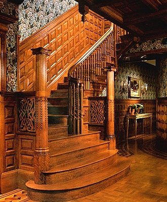 Staircase in a Tradtional Victorian Home: Lots of wood, moldings, ornamental carving, & busy, patterned wall coverings / http://www.erasofelegance.com/home/victorian1.html