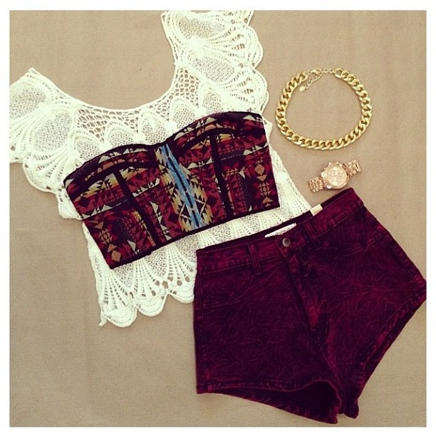 white lace crop top, high waist maroon jeans, and maroon tribal print bustier top