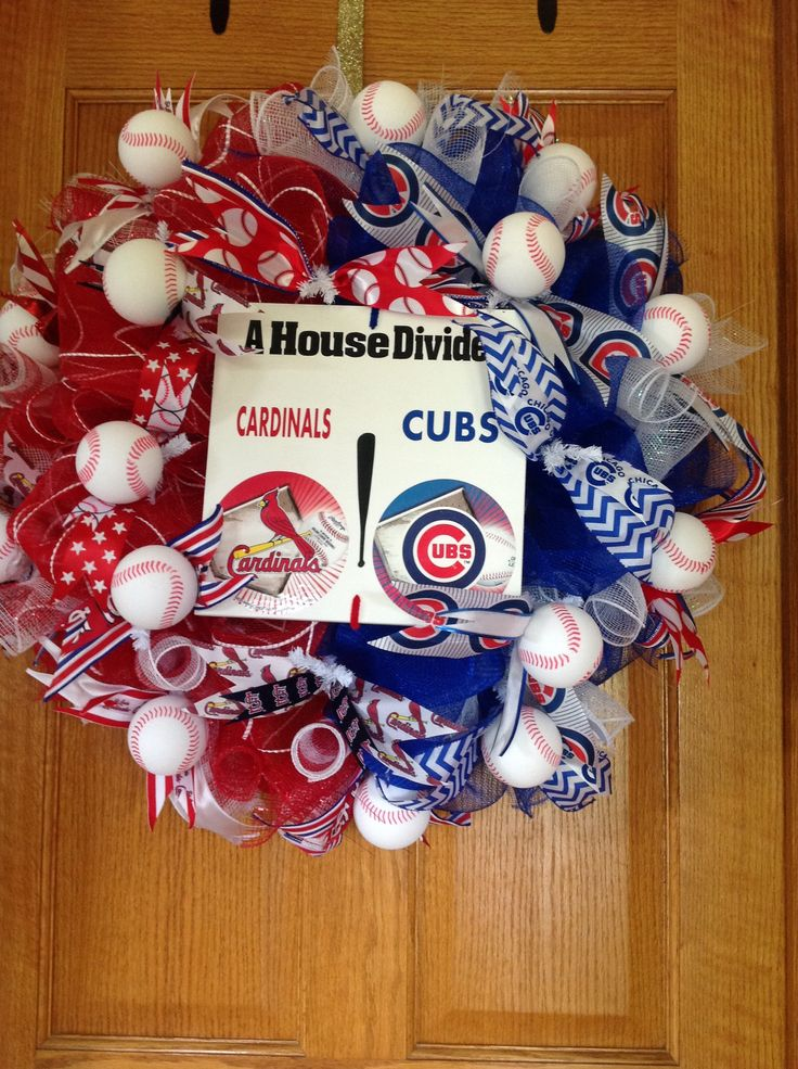 A house divided cubs and cardinals wreath. I think it woud be cute if the sign was the home plate.& use of less baseballs.