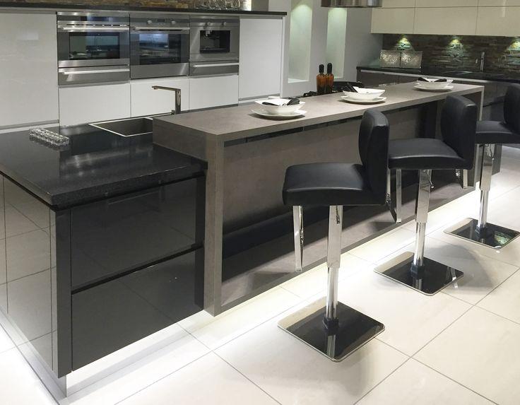 Modern kitchen island design with raised breakfast bar for Breakfast bar island ideas