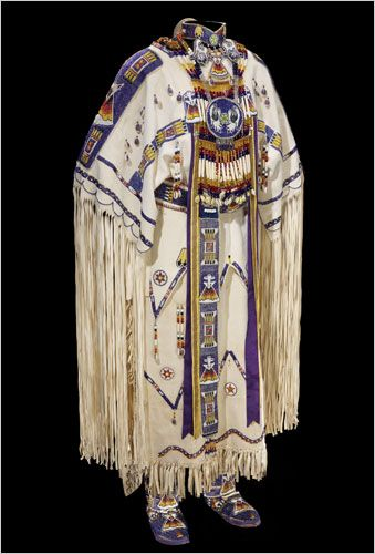 Native American Indian Traditional Clothing--The dresses, shown with moccasins, leggings and other handmade items, illuminate the vibrant artistic traditions of American Indian communities. Women who excelled at dressmaking always were held in high regard for contributing to their families' well-being, and their creations enhanced the status of their families within the tribal framework.