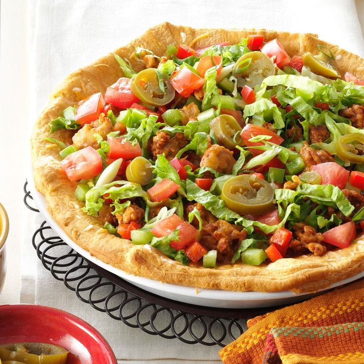 Chicken Taco Pie Recipe -This is truly a family fave and is perfect for a busy night of rushing to soccer, swimming lessons or scouts. I put it together in the morning and pop it in the oven when we get home. —Karen Latimer, Winnipeg, Manitoba