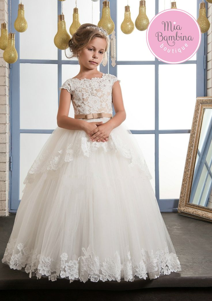 The Baltimore - a classy short sleeved floral girl dress with fitted lace bodice and full, flowy tulle skirt with an adorable scalloped lace overlay detail. The dress back features a zipper closure an