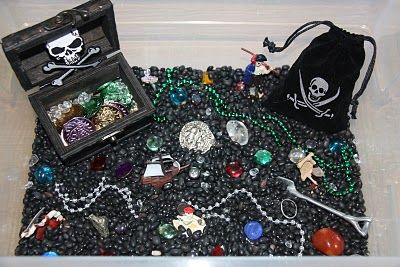 """Digging for buried treasure"" takes on a whole new meaning with Mari-Ann's pirate-themed sensory tub. Does the lady from Counting Coconuts know how to come up with cool stuff or what? Pinned by SPD Blogger Network. For more sensory-realted pins, see http://pinterst.com/spdbn"