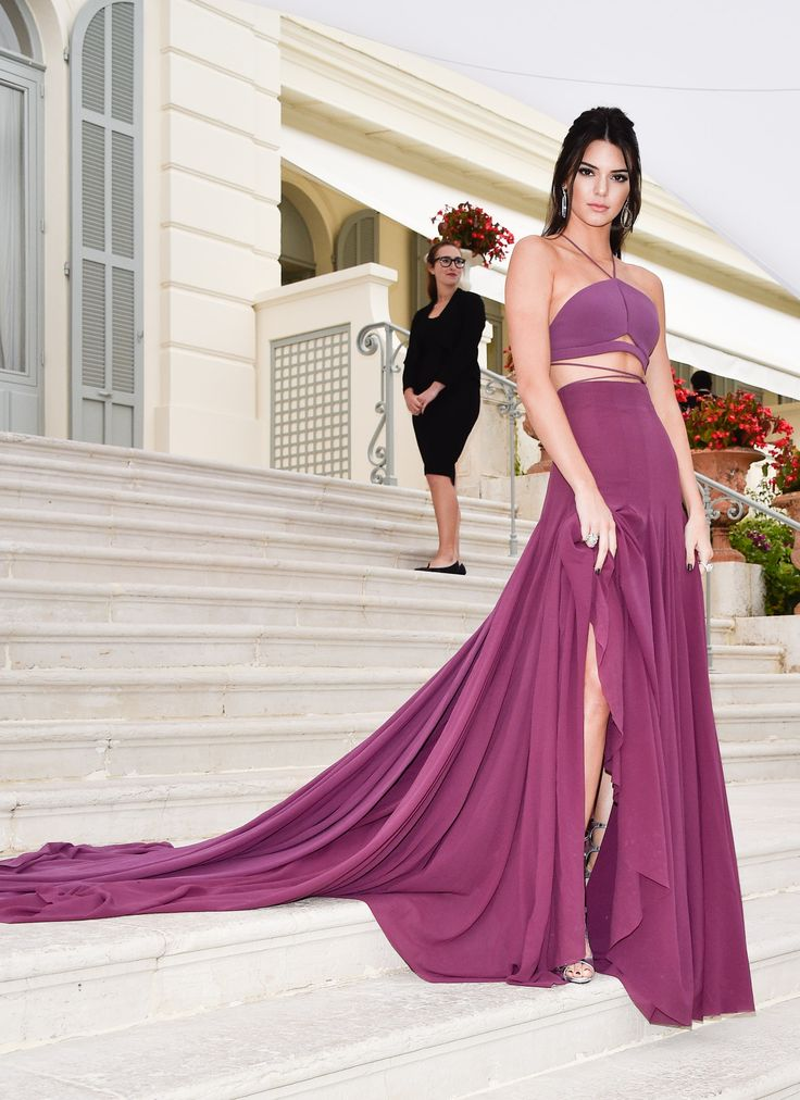 Another night in Cannes, another crop and maxi skirt combo. This time Kendall wore a purple coupling with a stair-draping, dramatic train, which she later whipped away to reveal a sexy bodycon number. - Cosmopolitan.co.uk