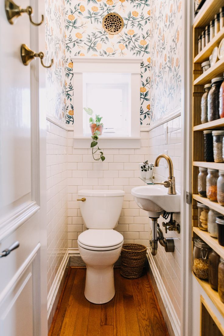 Hygge & West Copper Peonies wallpaper by Rifle Paper Co is the backdrop for this tiny first floor bathroom. This Tina Wall mounted sink is from Home Depot.