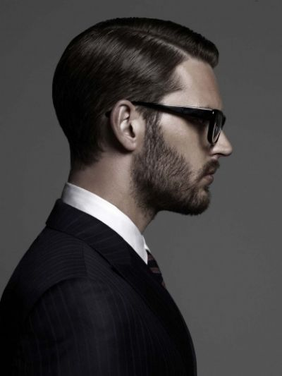 The combination of the parted classic slick hairstyle with the untamed beard looks simply amazing for men.