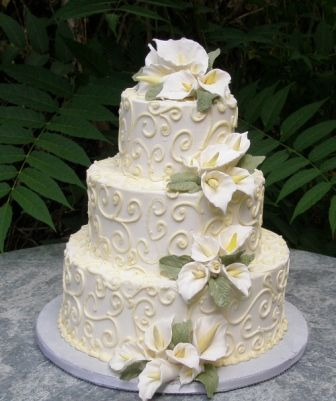 Wedding Cake with calla lily bunches and scroll work