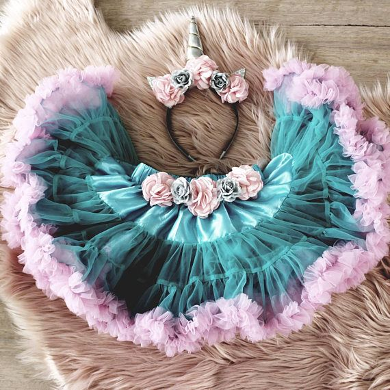 Our Unicorn Outfit is the ultimate outfit for your little ones first birthday or cake smash. The two tone tutu skirt has dual layers of tulle and is embellished with premium flowers. Please note the unicorn headband may vary slightly depending on materials available at the time of