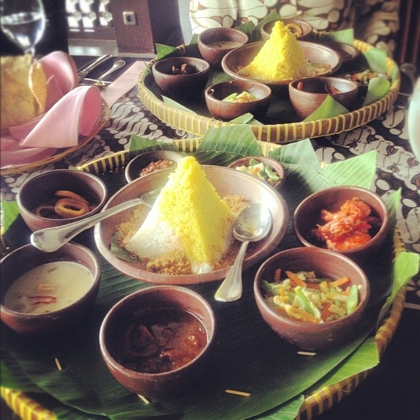 Nasi tumpeng with condiments