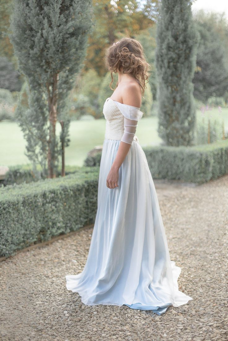A silk knit bridal bodice with off the shoulder sleeves accompanied with a blue chiffon skirt. Jessica Turner Designs